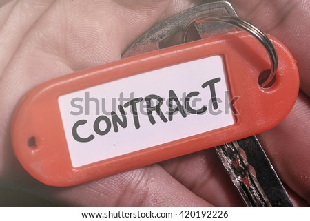 CONTRACT word written on key chain - stock photo