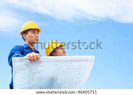 Contractor holding blueprint blue sky background stock photo image contractor holding blueprint with blue sky background malvernweather Choice Image