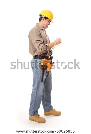 Contractor or architect builder standing full length while writing