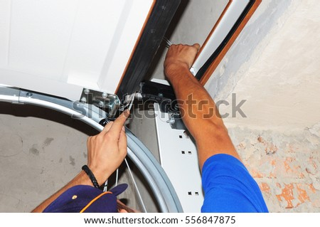 repair to how replace door garage fixing cost a spring springs replacement