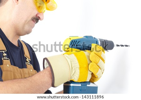 Contractor working with electric drill. The electrician - stock photo