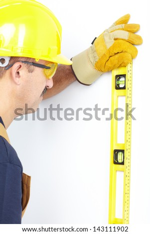 Contractor working with metre measure ruler. The carpenter - stock photo