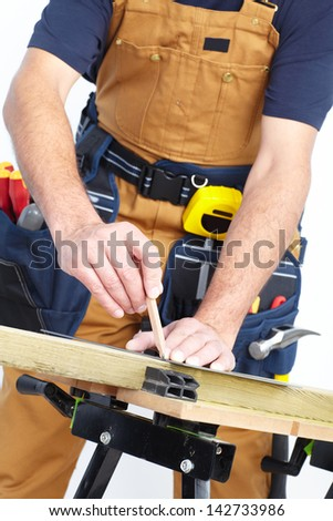 Contractor working with pencil and wooden board