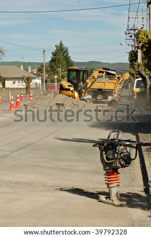 contractors carrying out street repairs in urban district - stock photo