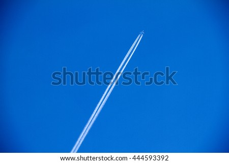 Contrail in blue sky