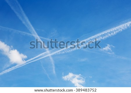 Contrails - vapors of airplanes left in the clear sky - or chemtrails, as conspiracy theorists call them