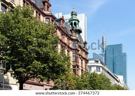 Contrast between contemporary and old building in Frankfurt am Main, Germany. Frankfurt is the largest financial centre in continental Europe. - stock photo