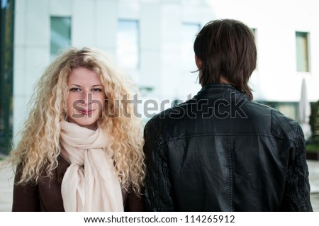 Contrast - woman and man - stock photo