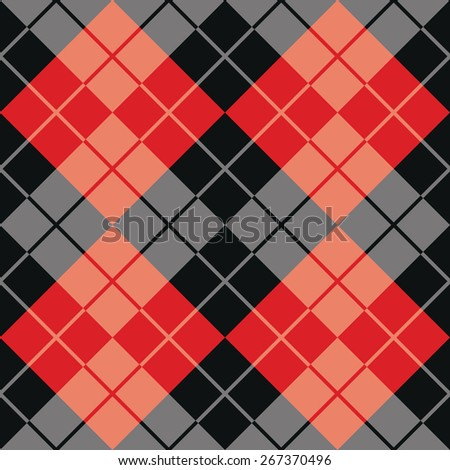 Contrasting argyle pattern in red and black. - stock photo