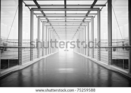 contrasty black and white airport hallway