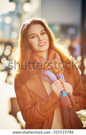 Contre-jour outdoor portrait of beautiful redhead young woman - stock photo