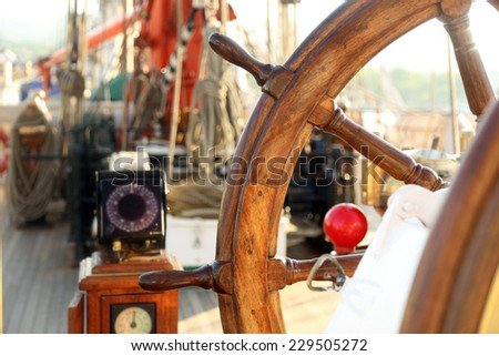 control and navigation of a sailing ship - stock photo