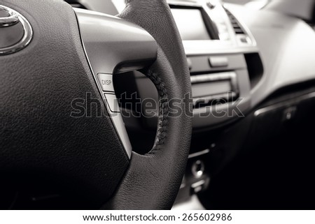 Control buttons on steering wheel - stock photo