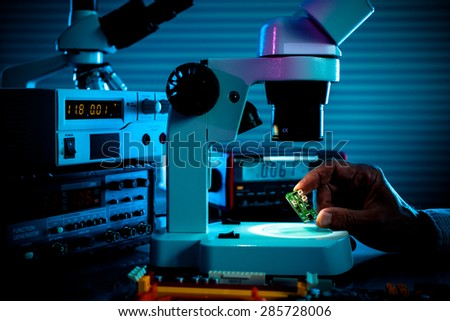 control microelectronic device in a laboratory microscope - stock photo