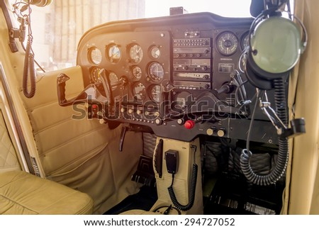 Control panel in a cockpit with instruments equipment. - stock photo