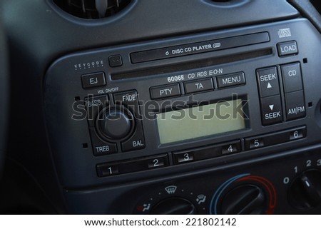Control panel of audio player in car - stock photo