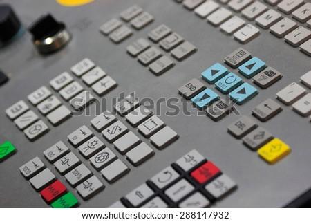 Control panel of CNC machine. Selective focus. - stock photo