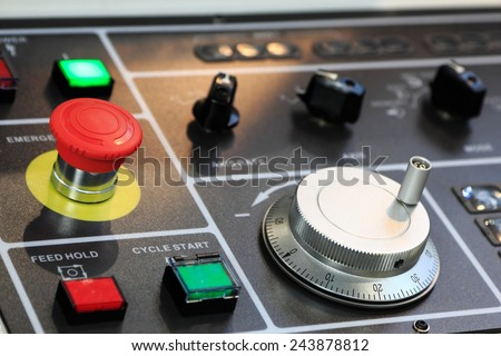 Control panel of CNC machining center. Shallow depth of field. - stock photo