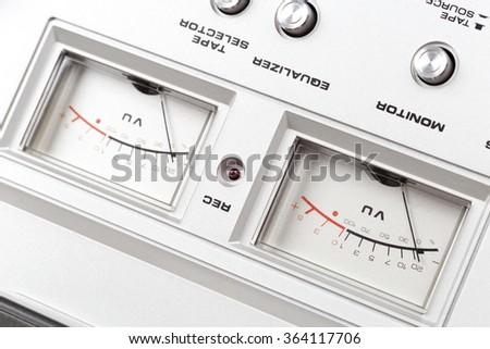 control panel of old reel tape recorder vu meter - stock photo