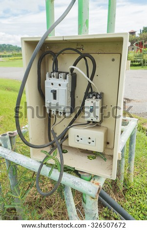 Control panel with circuit-breakers near the field - stock photo