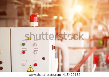 Control panel with rotating light. Buttons and switches on panel. Machine that distributes energy. Good knowledge is required. - stock photo