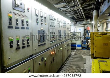 Control room of a extra large cargo retro ship - stock photo