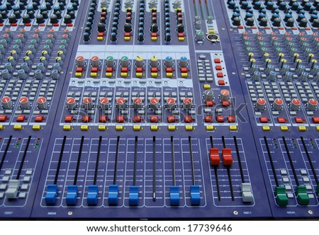Controls and buttons on audio mixer console - stock photo