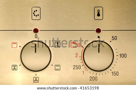 controls from a modern stainless steel oven - stock photo