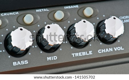 controls of a guitar amplifier, making macro - stock photo