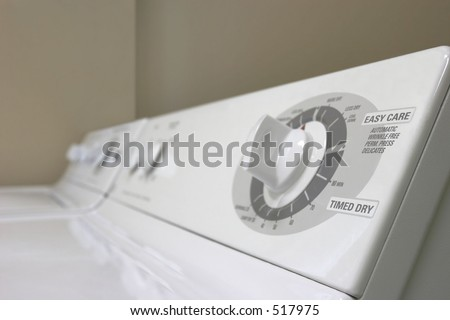 Controls of a washer and dryer - stock photo