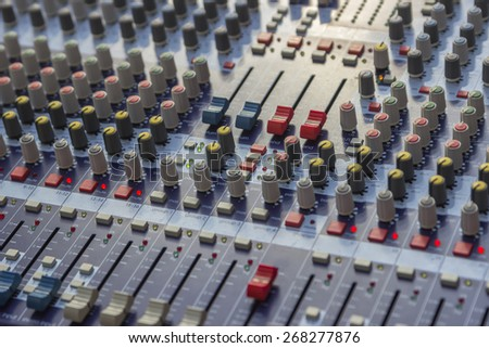 Controls of sound mixer control panel, mixer audio buttons. Selective focus and shallow dof. - stock photo