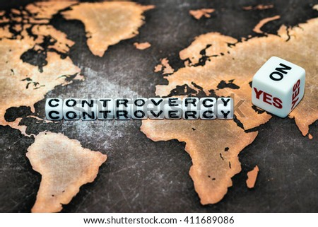 CONTROVERSY on cubes and Yes No dice - stock photo