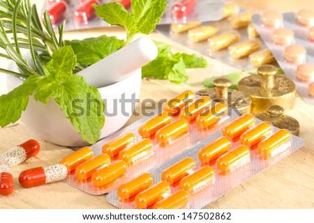 Conventional medicine and alternative medicine - stock photo