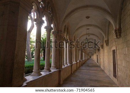 Converging lines of historic, stone cloister of  franciscan monastery in Dubrovnik, Croatia,
