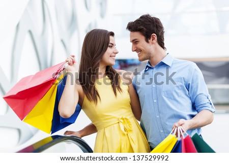 Conversing couple on shopping - stock photo