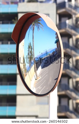convex mirror for traffic at the corners - stock photo