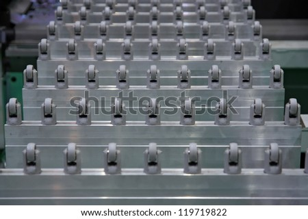 Conveyer belt. Factory track. Wood cutting machine. Woodworking machine. Conveyor belt. - stock photo
