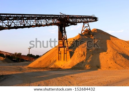 Conveyor at gravel pit hill  - stock photo