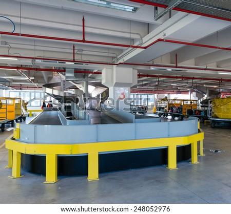 Conveyor belt in terminal - stock photo