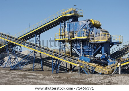 Conveyor belt in the quarry - stock photo