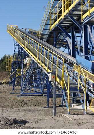 Conveyor belt in the quarry - stock photo