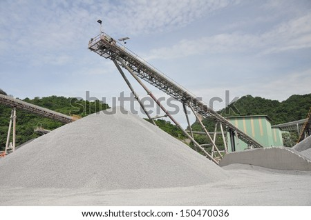Conveyor belts with piles of gravel - stock photo