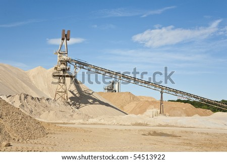 Conveyor on site at gravel pit hill - stock photo