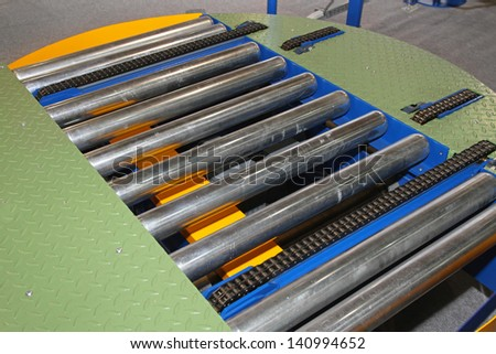 Conveyor rollers for moving goods through factory line - stock photo