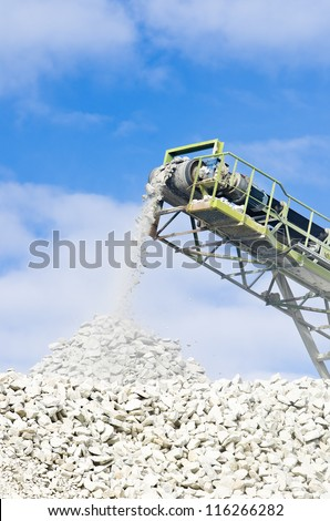 conveyor used for conveying crushed granite stone in a quarry - stock photo