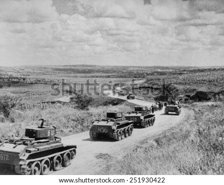 Convoy of Soviet (Russian) tanks in Romania during the annexation of Bessarabia, Romania, in 1940. - stock photo