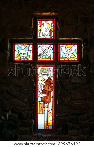 COOBER PEDY, AUSTRALIA - December 1. Stained glass windows with icons and religious symbols in the Catholic under ground church on December 1, 2015 in Coober Pedy. - stock photo