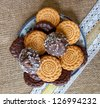 coockies on a plate on sacking cloth - stock photo