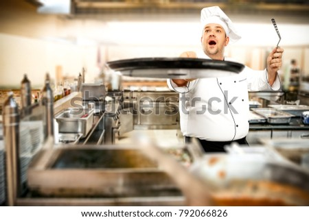 Cook chef in kitchen interior. Kitchen tools and free space for your decoration.