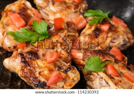 cook chicken piece with spice on frying pan